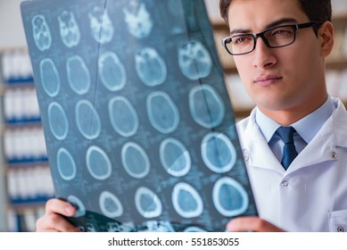 Young doctor looking at computed tomography x-ray image