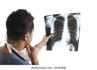 Young doctor looking X-Ray image on isolated white background