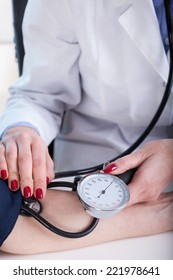Young doctor measuring a pressure her middle aged patient