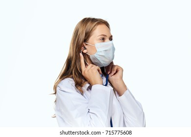young doctor in medical mask on isolated background