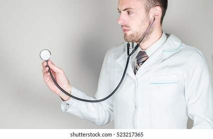 young doctor on a white background