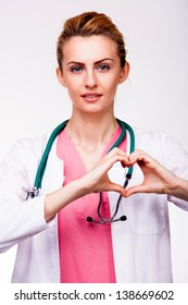 young doctor showing heart sign