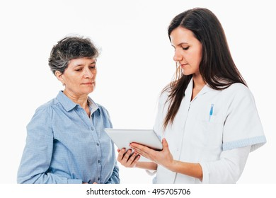 Young doctor showing on the tablet the test results to her patient - isolated on white.