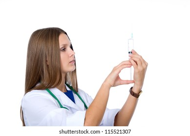 Young doctor with syringe on a white background