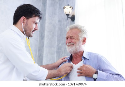 Young doctor is using a stethoscope to check heart of senior patient