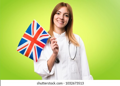Young doctor woman holding an United Kingdom flag on colorful background