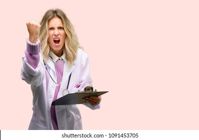 Young doctor woman, medical professional irritated and angry expressing negative emotion, annoyed with someone