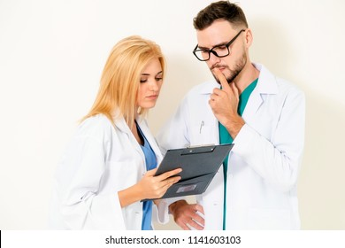 Young doctors coworker thinking on white background. Healthcare and medical service concept.