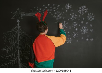 young drawing and decorating christmas