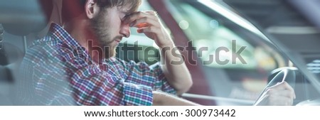 Young driver is depressed because of his problems