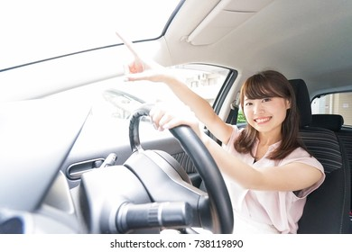 Young driver pointing something