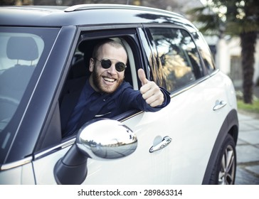 Young driver showing thumb up gesture