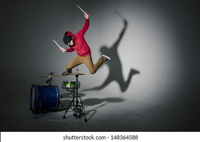young drummer jumping while playing