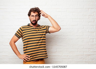 young dumb man with a goofy, dumb, silly look, feeling shocked and confused at a recent realization, not really understanding an idea.