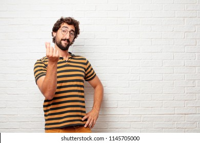 young dumb man looking happy, proud and satisfied, gesturing cash or money, announcing profitable business with a symbol for currency or richness.