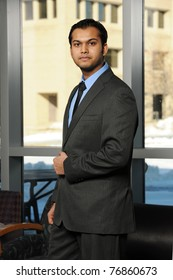 Young Eastern businessman inside an office building