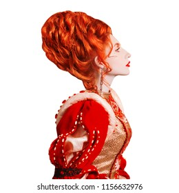 Young edwardian redhead queen with hairstyle isolated on white background. Renaissance princess with red hair isolated. Fairytale queen in red dress. Edwardian duchess with ring on finger.