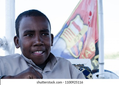 A young Egyptian Nubian boy sitting in a Boat in the River Nile in Aswan, Egypt. February 2017