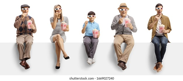 Young and elderly people sitting on a panel eating popcorn and watching a 3d movie isolated on white background