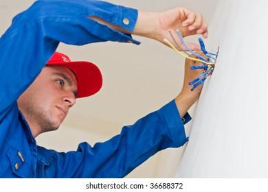Imágenes, fotos de stock y vectores sobre Man Wiring Home ... on building a home, framing a home, air conditioning a home, heating a home, painting a home,