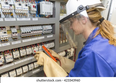young electrician woman at work