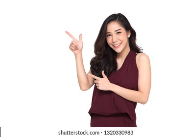 Young elegant Asian woman smiling and pointing to empty copy space isolated on white background