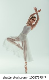 young elegant ballet dancer in white dress, isolated on white