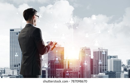 Young elegant businessman with diary in hands looking away