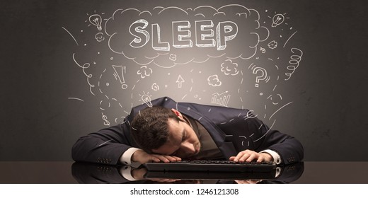 Young elegant businessman fell asleep at his workplace with doodled idea, sleep and tired concept