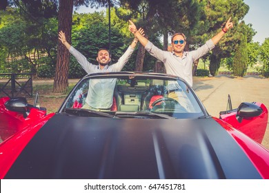 Young elegant businessmen cheerful in convertible car. Concept of success