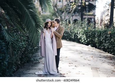Young elegant fashion couple in park