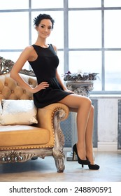 young elegant lady in luxury vintage interior, soft focus