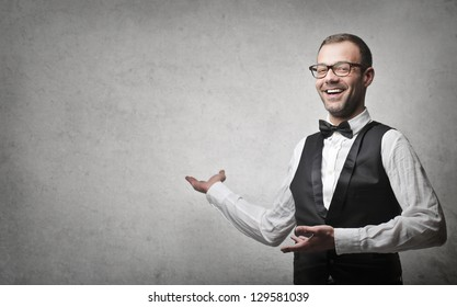 young elegant man on gray background