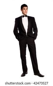 young elegant man in tuxedo, studio shot on white