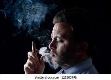 Young Elegant Portrait of a businessman smoking cigar