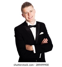 young elegant smiling man in tuxedo isolated on white