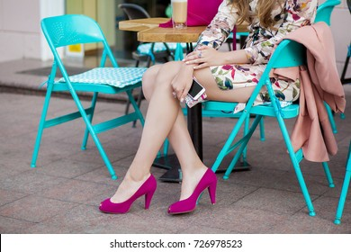 young elegant stylish woman sitting in cafe, spring summer fashion trend