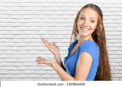 Young elegant woman pointing