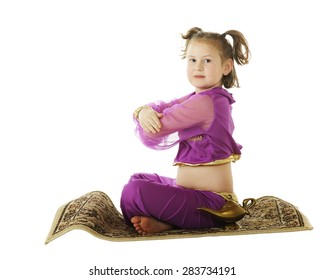 """A young elementary """"genie"""" coming in for a landing on her flying carpet.  Isolated on white,"""