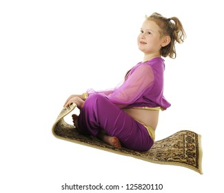 """A young elementary """"genie"""" happily riding a flying carpet.  On a white background."""