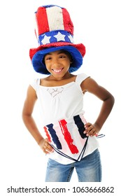 A young elementary girl happily showing off her American patriotic outfit.  On a white background.