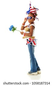 A young elementary girl possing in her choice of patriotic clothing.  On a white background.