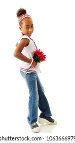A young elementary girl in red, white and blue, daintily stepping forward with a small bouquet of red flowers.  On a white background.