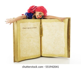 """A young elementary """"rag doll"""" flopped across a giant book, opened to the words """"Once upon a time.""""  The rest of the page is left blank for your text.  On a white background."""