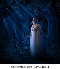 Young elf girl in night forest