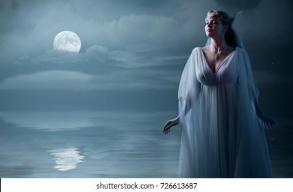 Young elven girl at sea shore