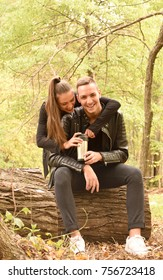 Young embraced couple sitting in autumn park