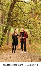 Young embraced couple taking a walk in autumn park