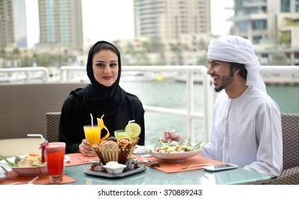 Young Emirati arab couple dining in a restaurant in Dubai