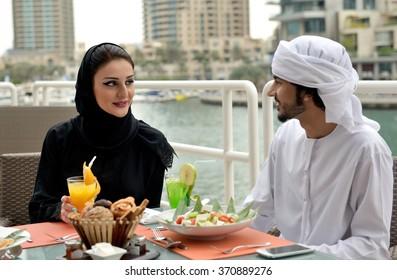 Young Emirati arab couple dining in a restaurant in Dubai